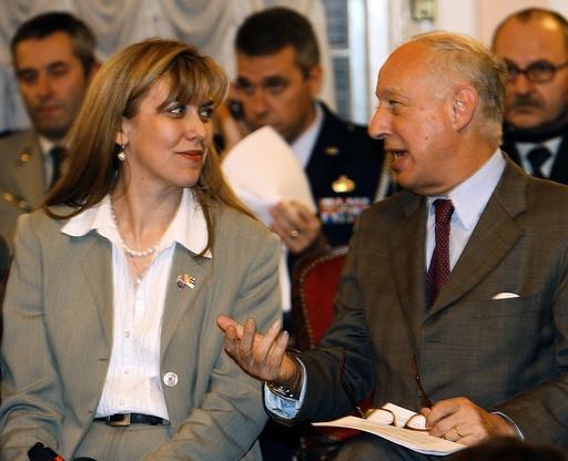 NATO Deputy Secretary General Alessandro Minuto Rizzo talks with Snezana Samardzic Markovic, assistant to Serbian Defence Minister, during a news conference in Belgrade