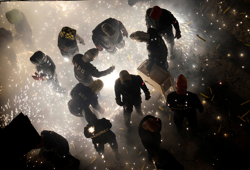 Revellers play with fireworks during the annual