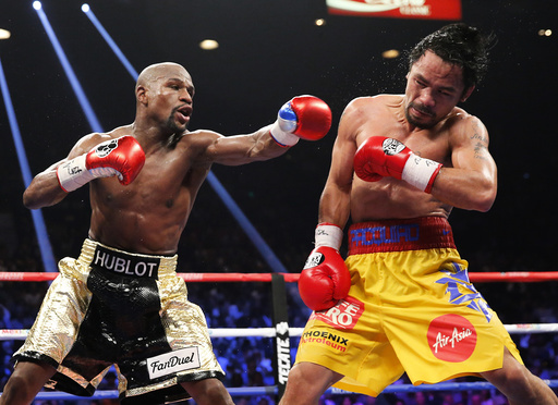 Mayweather, Jr. of the U.S. lands a left to the face of Pacquiao of the Philippines in the 11th round during their welterweight title fight in Las Vegas