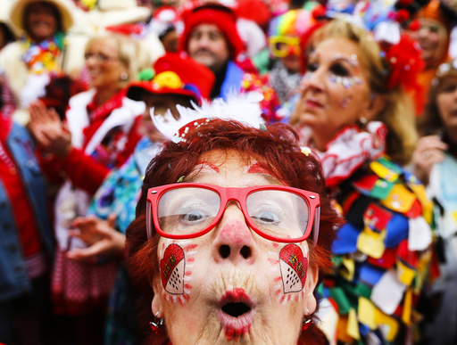 A carnival reveller celebrates the start of the carnival season in Cologne