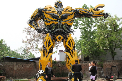 People look at a replica of a Transformer, made by a fan, in Shangqiu