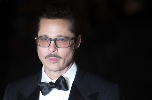 U.S. actor Brad Pitt poses before a gala screening of his film