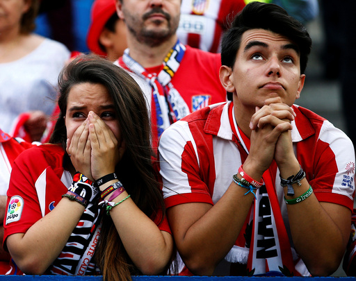 Atletico Madrid fans react during the last match at Vicente Calderon as Atletico Madrid bids farewell to its home of 51 years before moving to the newly-built Wanda Metropolitano, in Madrid