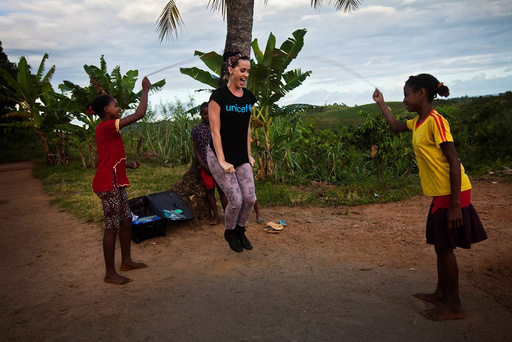 Handout photo of U.S. singer Perry joining girls playing with a jump rope during a visit to a primary rebuilt by UNICEF in Ampihaonana