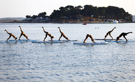 People practise Metta Float Yoga at the adriatic cost in Meduli