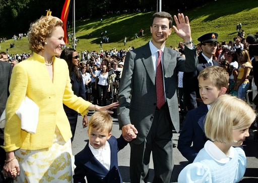 Hereditary Prince Alois von und zu Liechtenstein and his family wave to the people on their way to Vaduz castle