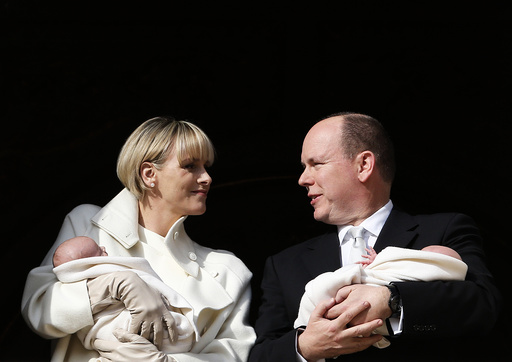 Prince Albert II of Monaco and his wife Princess Charlene hold their twins Prince Jacques and Princess Gabriella as they stand at the Palace Balcony during the official presentation of the Monaco's newborn royals in Monaco