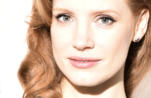 Actress Jessica Chastain poses during a media event for her forthcoming film, 'A Most Violent Year', at a hotel in central London