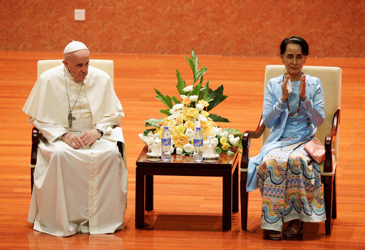 Myanmars State Counsellor Aung San Suu Kyi applauds next to Pope Francis as they attend a meeting with members of the civil society and diplomatic corps in Naypyitaw, Myanmar