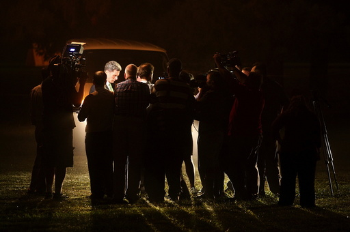 Members of the media listen to the witnesses following the execution of Kelly Gissendaner at the Georgia Diagnostic and Classification Prison in Jackson