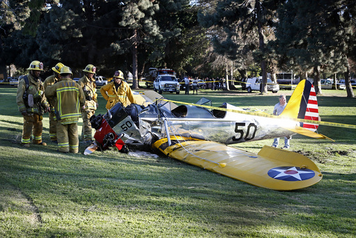 An airplane sits on the ground after crash landing at Penmar Golf Course in Venice, Los Angeles CA