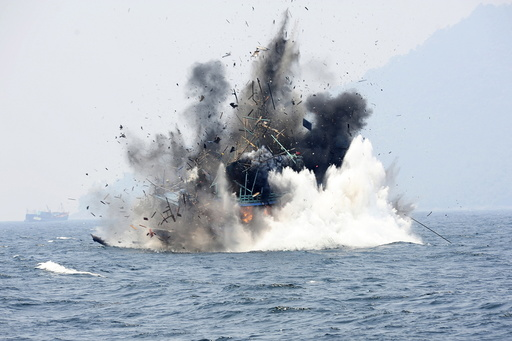 A foreign fishing boat confiscated for illegal fishing is blown up by the Indonesian Navy off of Lemukutan Island, West Kalimantan, Indonesia