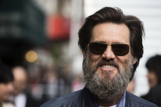 Comedian Jim Carrey arrives at the Ed Sullivan Theater in Manhattan to take part in the taping of tonight's final edition of