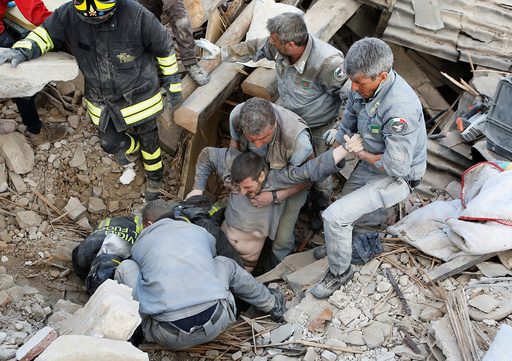 A man is rescued alive from the ruins following an earthquake in Amatrice