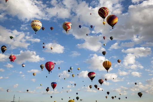Hot air balloons lift off on the first day of the 2015 Albuquerque International Balloon Fiesta in Albuquerque, New Mexico