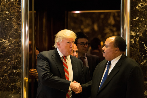U.S. President-elect Donald Trump shakes hands with Martin Luther King III, an American human rights advocate, at Trump Tower in Manhattan