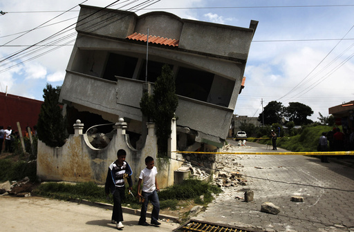 An earthquake-damaged house is pictured in the San Marcos region, in the northwest of Guatemala