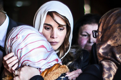 Jordan's Queen Rania offers her condolences to the family of Jordanian pilot Muath al-Kasaesbeh, at their family home of Muath in the city of Karak