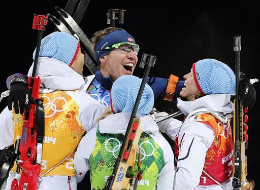 Norway's BjoerndalenSvendsen Eckhoff and Berger celebrate winning mixed biathlon relay at 2014 Sochi Olympic Games