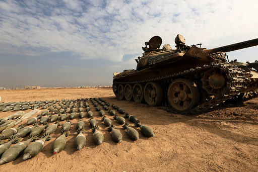 A captured Islamic State tank and shells are seen at the Iraqi army base in Qaraqosh, east of Mosul, Iraq