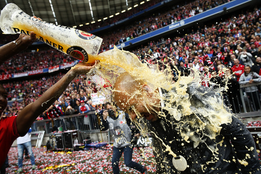 Bayern Munich's Alaba pours beer over coach Guardiola after their final German first division Bundesliga soccer match of the season against FSV Mainz 05 in Munich