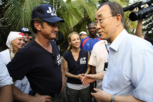 U.N. Secretary-General Ban is greeted by actor and director of J/P HRO Penn and actress Bello, member of J/P HRO, during a visit at IDP camp in Port-au-Prince