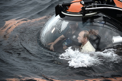 Russian President Vladimir Putin is seen inside a research bathyscaphe while submerging into the waters of the Black Sea near Sevastopol