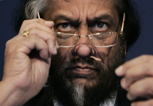 Nobel Peace Prize Winner Pachauri attends a session of the World Economic Forum in Davos