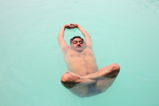 People preactice water yoga in a pool in preparation for the International Day of Yoga in Bhopal