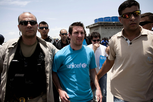 Argentinian soccer player and UNICEF Goodwill Ambassador Lionel Messi walks on a street during his visit to Port-au-Prince