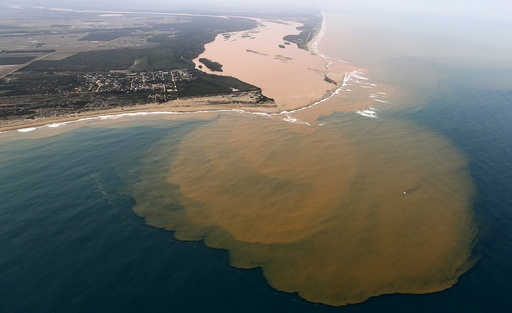 An aerial view of the Rio Doce, which was flooded with mud after a dam owned by Vale SA and BHP Billiton Ltd burst, at an area where the river joins the sea on the coast of Espirito Santo in Regencia Village