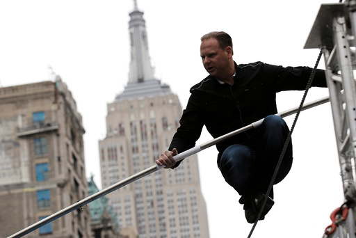 Aerialist Nik Wallenda walks a tightrope during a promotional event in New York
