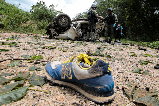 Military personnel inspect the site of a bomb attack at Krong Pinang District district in the troubled southern province of Yala