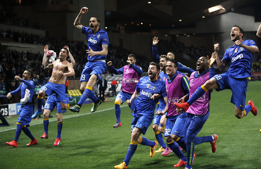 Juventus players celebrate after their team's qualification for the semi-final of the Champions League at the end of their quarter-final second leg soccer match against Monaco at the Louis II stadium in Monaco
