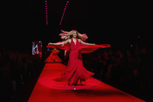 Actress Laverne Cox walks in a Donna Karan creation during a presentation of the Go Red for Women Red Dress collection during New York Fashion Week