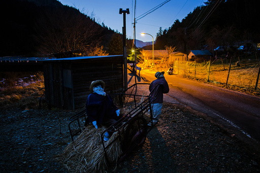 Scarecrows are seen at sunset in Nagoro
