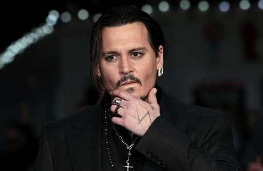 Actor Johnny Depp arrives for the British premiere of the film