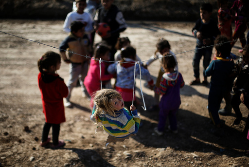 Displaced Iraqi children who fled the Islamic State stronghold of Mosul with their families play at Khazer camp