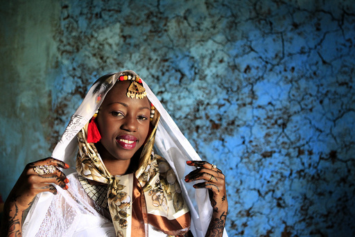 Kenyan bride Hawa Abdulkadir poses for a photograph during her traditional Nubian wedding ceremony in Nairobi's Kibera Slum