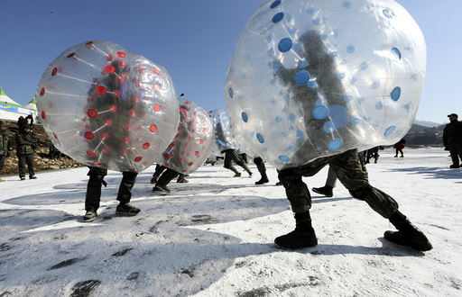 Soldiers engage in a bubble battle during annual ice fishing festival in Inje