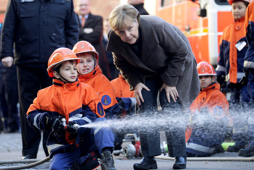 German Chancellor Merkel visits a youth fire brigade at Wedding in Berlin