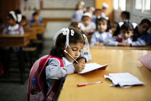 Palestinian schoolchildren attend a class at a U.N.-run school in Dir al-Balah in the central Gaza Strip, on the first day of the school year