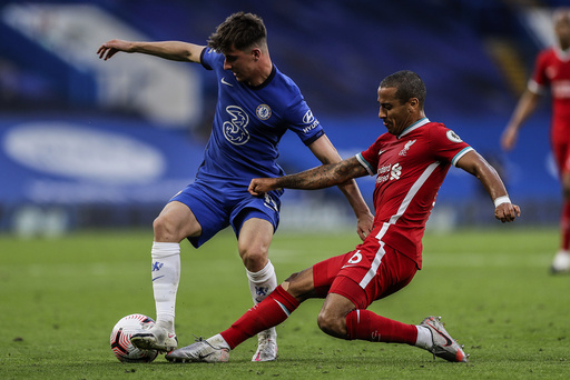Chelsea's Mason Mount, left, duels for the ball with Liverpool's Thiago during the English Premier League soccer match between Chelsea and Liverpool at Stamford Bridge Stadium, Sunday, Sept. 20, 2020. (AP Photo/Matt Dunham, Pool)