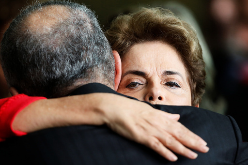 Brazil's former President Dilma Rousseff, who was removed by the Brazilian Senate from office earlier, is greeted by former defense minister Aldo Rebelo at the Alvorada Palace in Brasilia