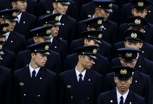 Members of the Tokyo fire department march during a New Year performance in Tokyo, Japan