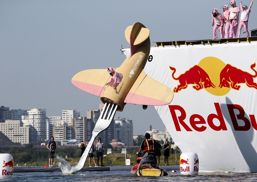 A participant attempts to control a craft during the Red Bull Flugtag Russia 2015 competition in Moscow