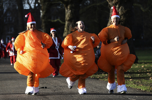Participants dressed as turkeys take part in a Santa Run at Battersea Park in London