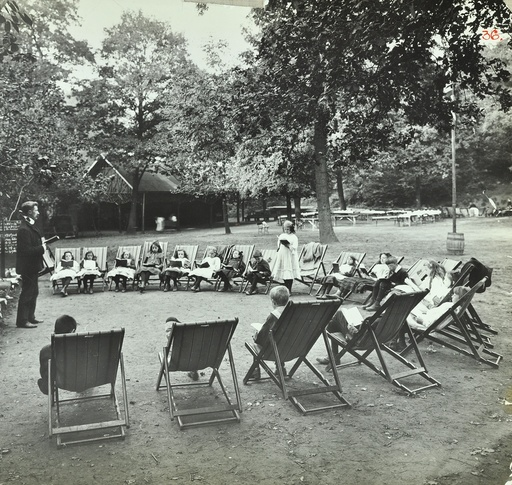 Reading lesson outside, Bostall Woods Open Air School, London, 1907. Artist: Unknown.