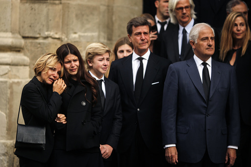 Children of Spain's Duchess of Alba Cayetana Fitz-James Stuart y Silva and other relatives cry as they leave the townhall for her funeral in Seville