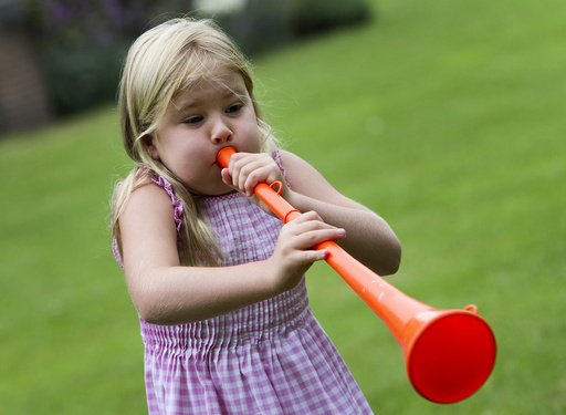 Princess Catharina-Amalia, daughter of Netherlands' Crown Prince Willem Alexander and Princess Maxima, blows an orange vuvuzela in Wassenaar